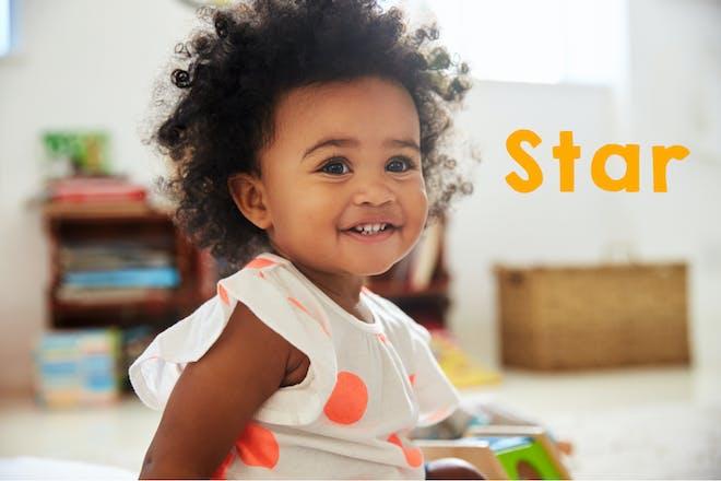 Smiling baby girl in playroom