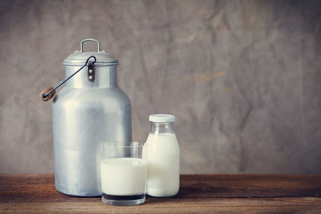 Milk churn, glass and bottle filled with milk