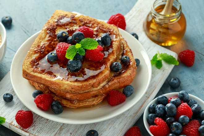 French toast with blueberries, raspberries and honey
