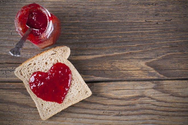 Bread and jam in the shape of a heart