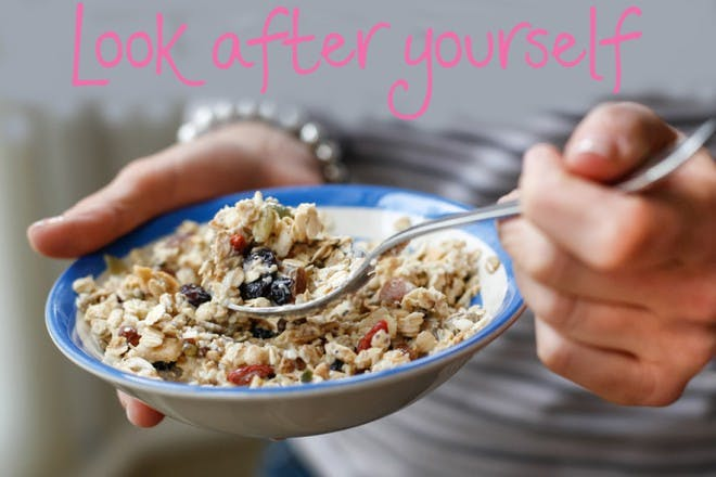 woman eating granola from bowl