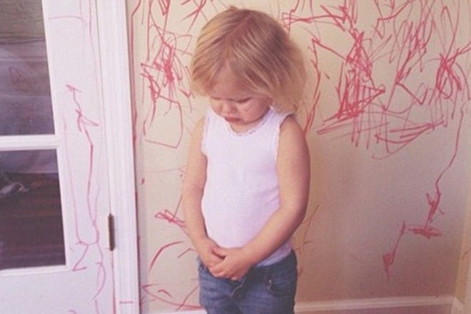naughty girl drawing on the walls