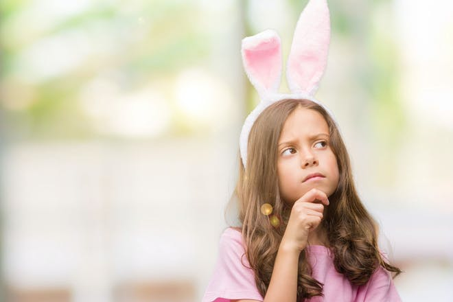 Confused girl with Easter bunny ears