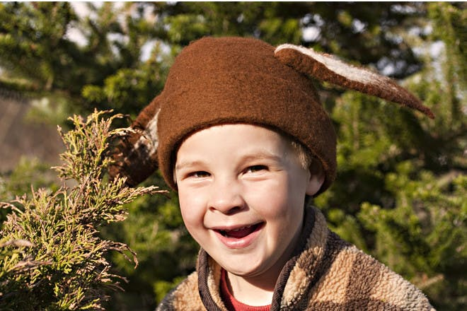 little boy in hat with bunny ears sewn on
