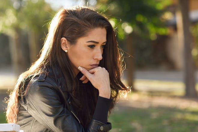 Woman looking sad outside
