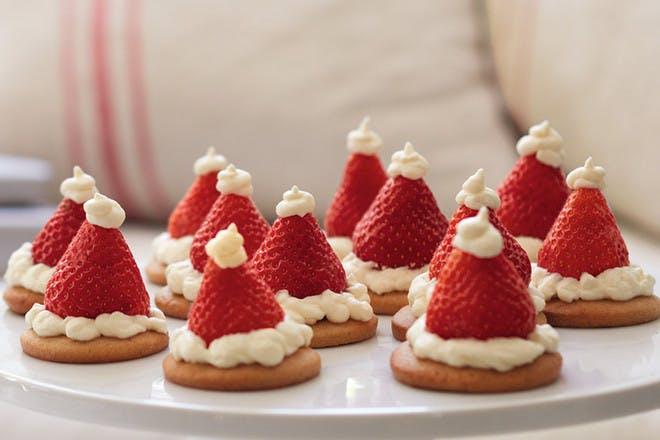 Strawberry Santa hats on vanilla Christmas biscuits recipe