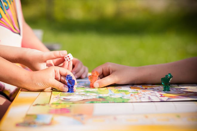 kids playing board games outside