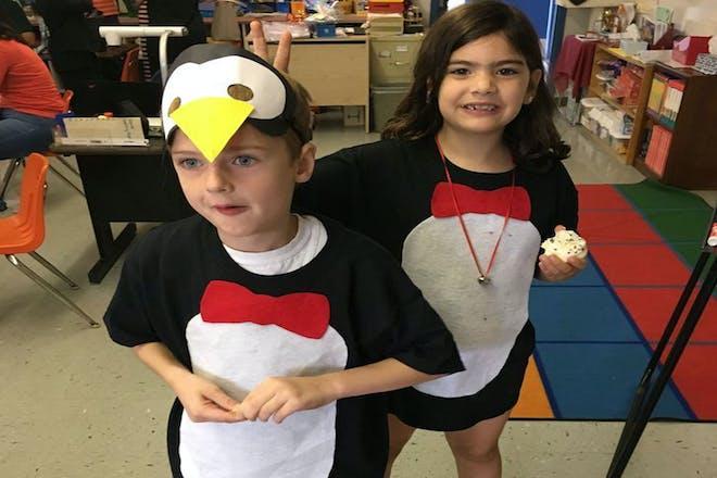 Kids dressed as penguins