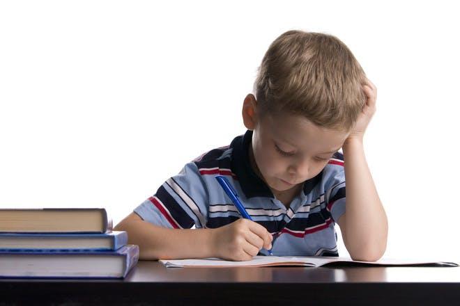 Child with dyslexia struggling to write