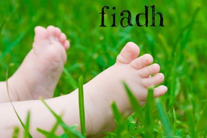 baby feet in grass