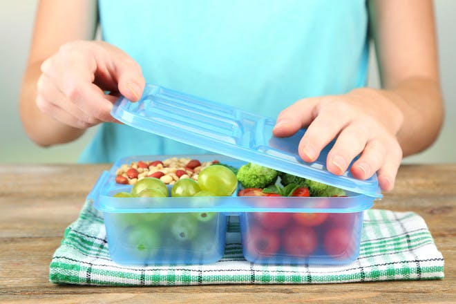 Woman packing school lunchbox
