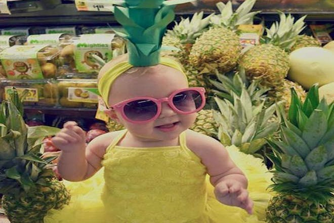 Baby dressed as a pineapple