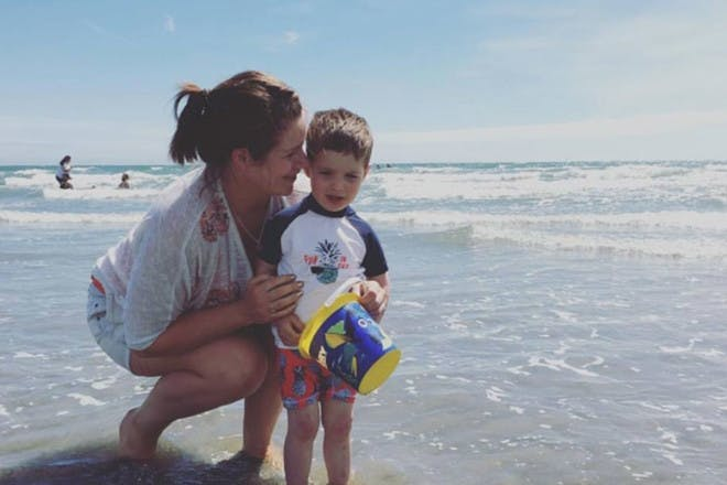Mum and toddler on beach