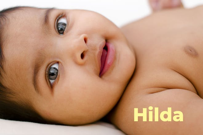 Baby looking at camera. Name Hilda written in text