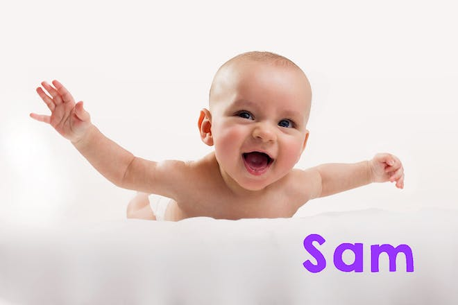 Baby laughing and raising arms while lying on tummy. Text says Sam
