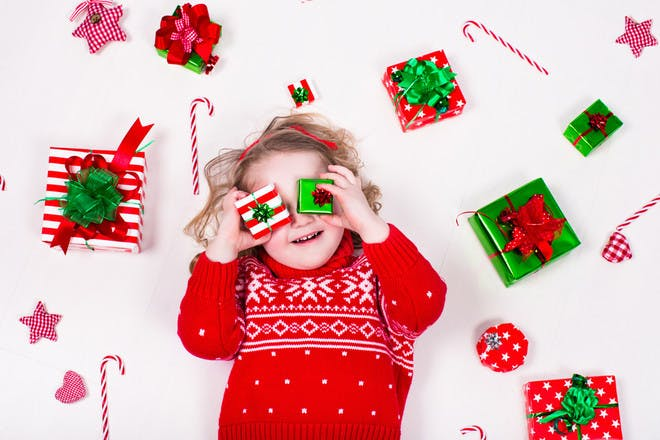 Child surrounded by christmas presents