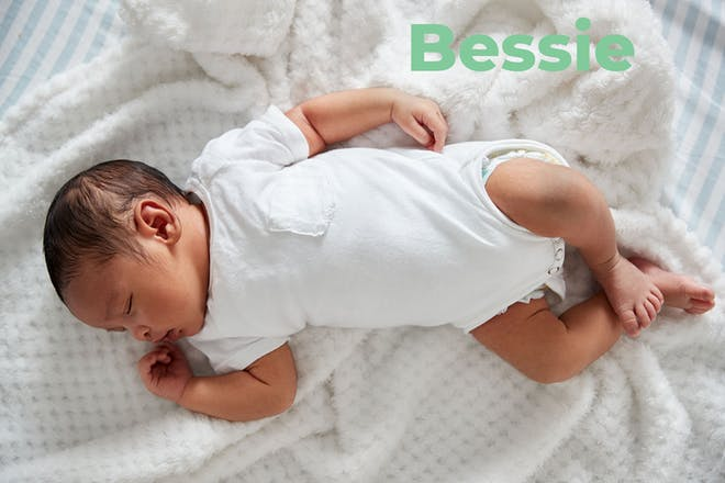 Baby lying down sleeping. Name Bessie written in text