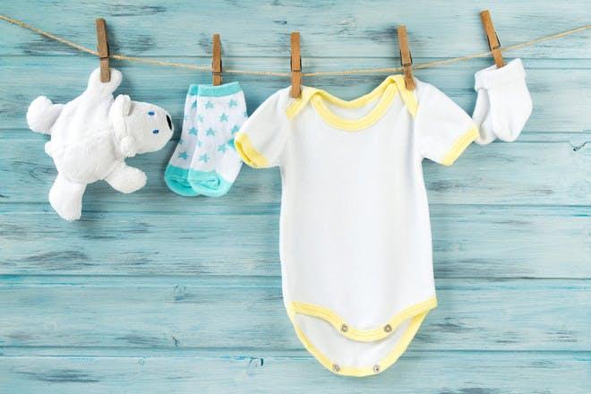Baby grow hanging on washing line