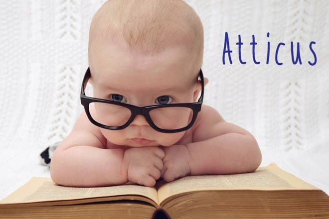 baby with glasses reading book