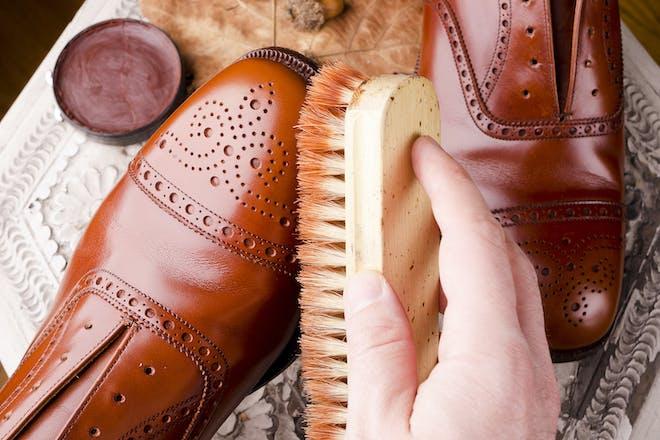 Man polishing brown brogues