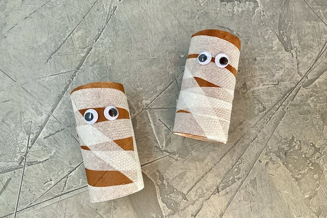 DIY mummy toilet paper roll with googly eyes for Halloween