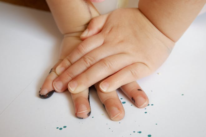 Toddler hands with paint