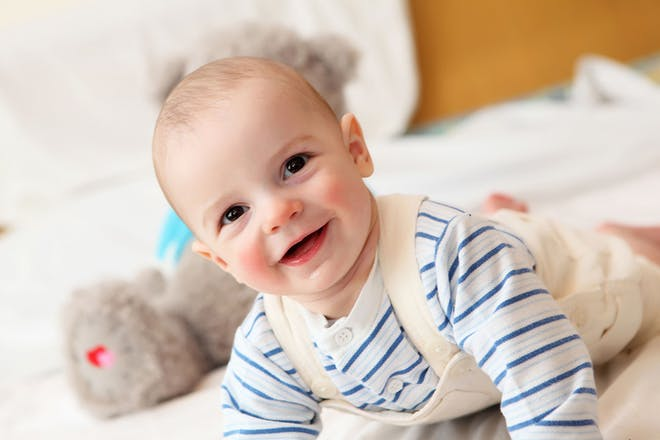 baby crawling in dungarees