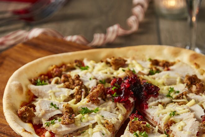Gluten-free Christmas leftovers pizza with turkey, stuffing and cranberry sauce