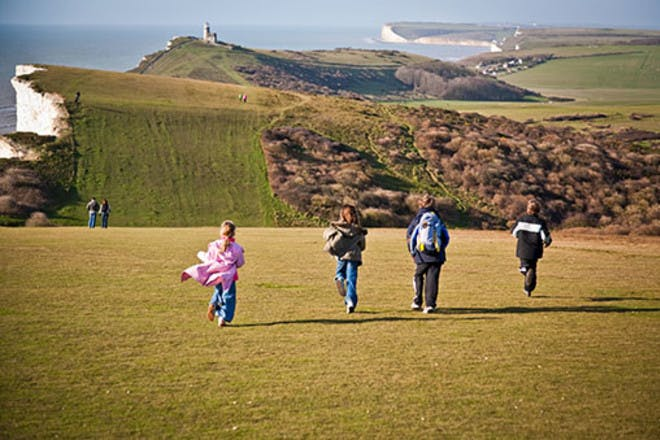 Children running by south downs