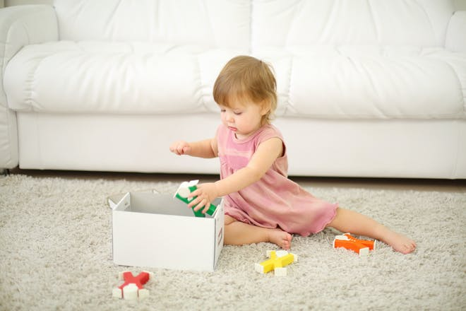 Toddler with box