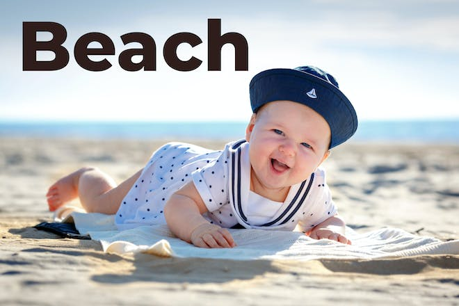 baby on the beach with Beach written in text