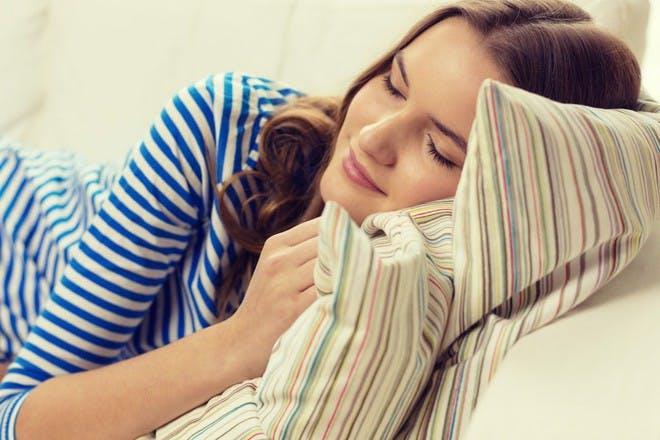 woman in striped shirt lying down