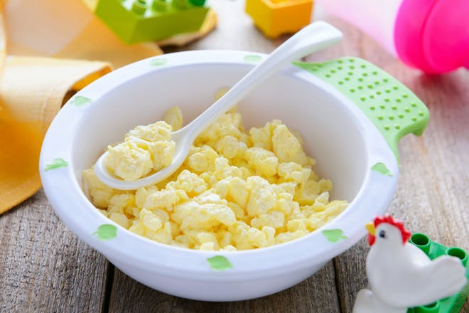 Scrambled egg in baby or toddler bowl