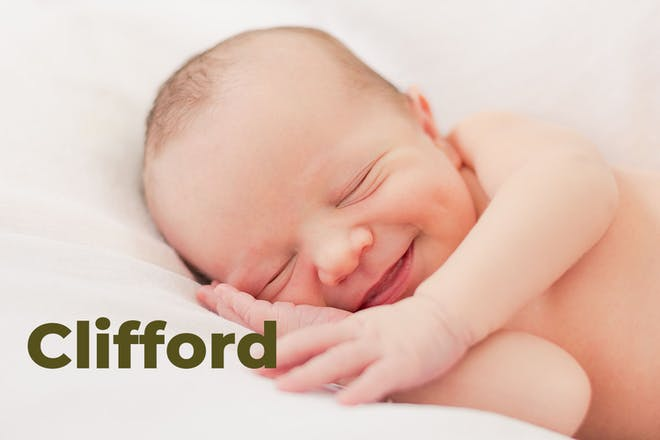 Smiling baby lying down, name Clifford written in text