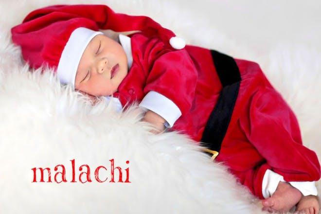 sleeping baby in santa suit