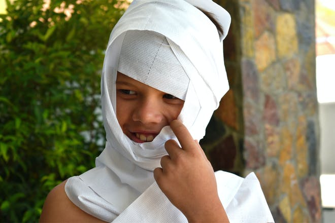 Child dressed up as a toilet paper mummy for Halloween