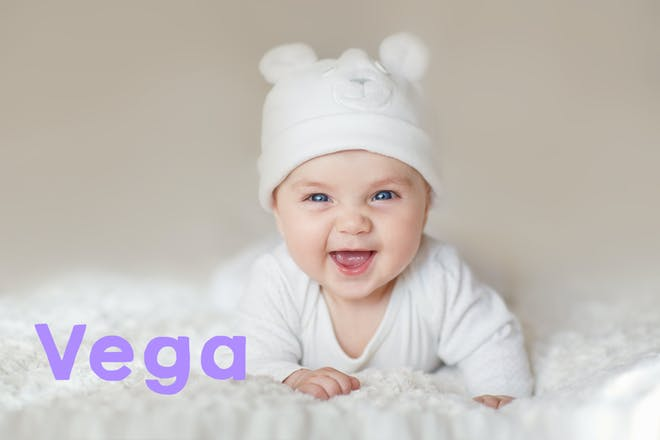 Baby on bed laughing