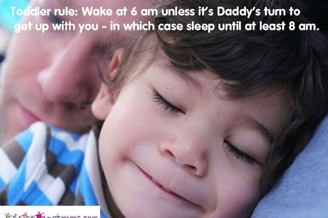 child sleeping next to father