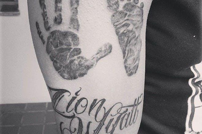 hand and footprint tattoo