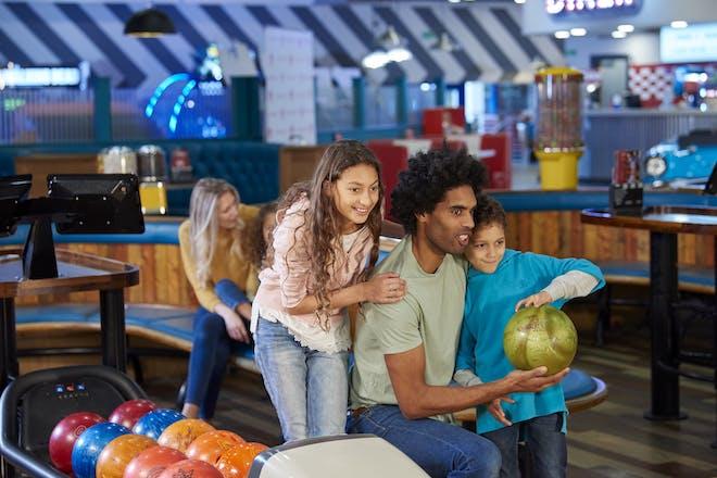 Family at ten pin bowling centre