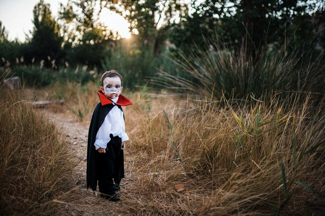 A little boy dressed as Dracula