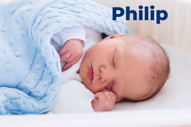 Baby sleeping with blue blanket. Name Philip written in text