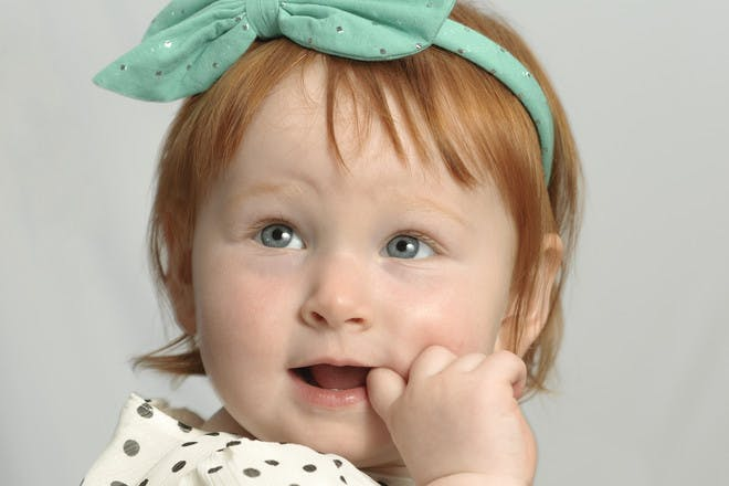 little girl with finger in her mouth