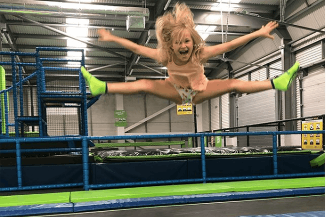Girl jumping and doing splits in air