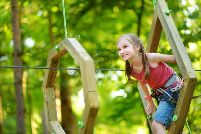 Little girl playing in adventure playground