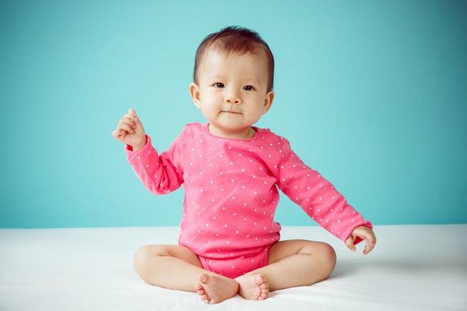 Baby girl in pink onesie