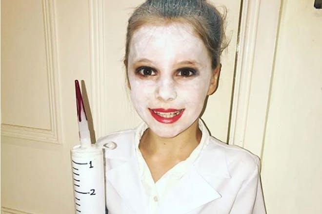 Little girl dressed as The Demon Dentist