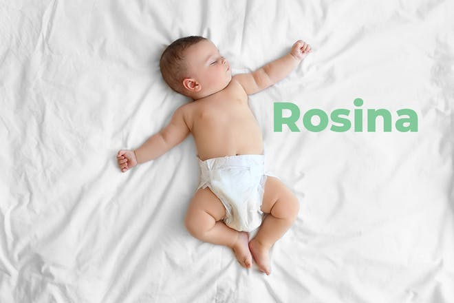 Sleeping baby sprawled out on bed. Name Rosina written in text