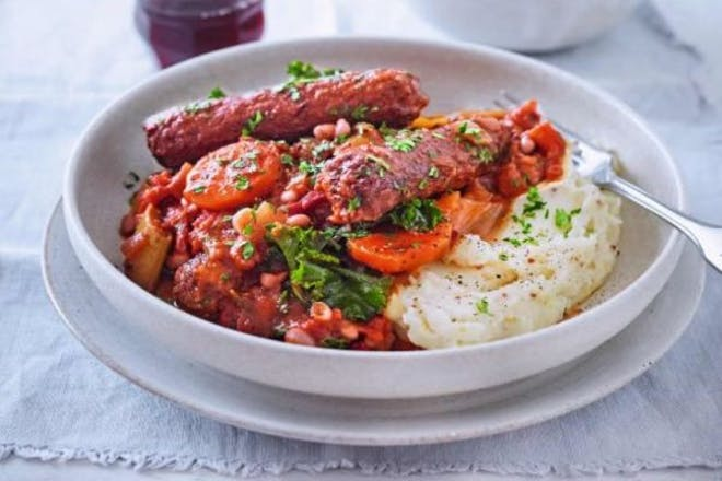 bowl of veggie sausage and bean stew served with mash