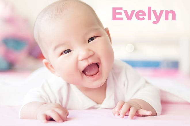 Baby crawling towards camera. Name Evelyn written in text